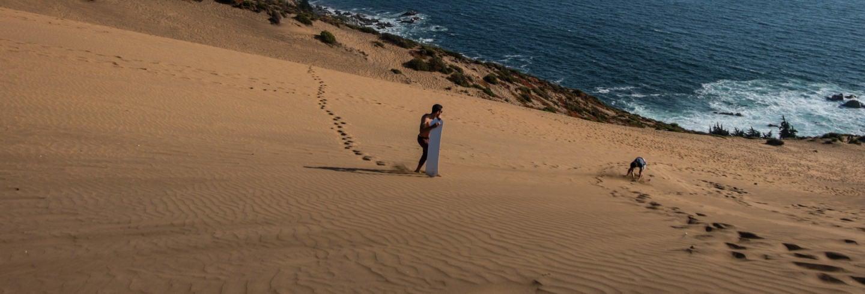Sandboarding dans les dunes de Concón