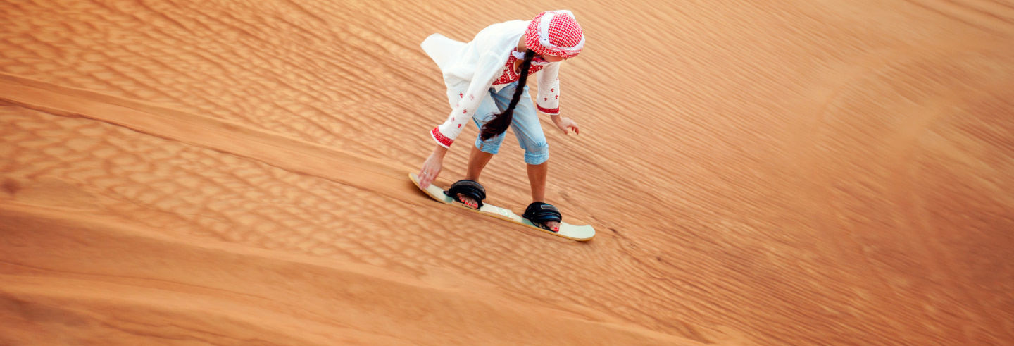 Sandboarding in the Dubai Desert