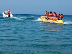 Speeding along Miami's coast line on a banana boat
