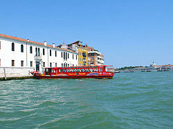 Tourist boat along the canals of Venice