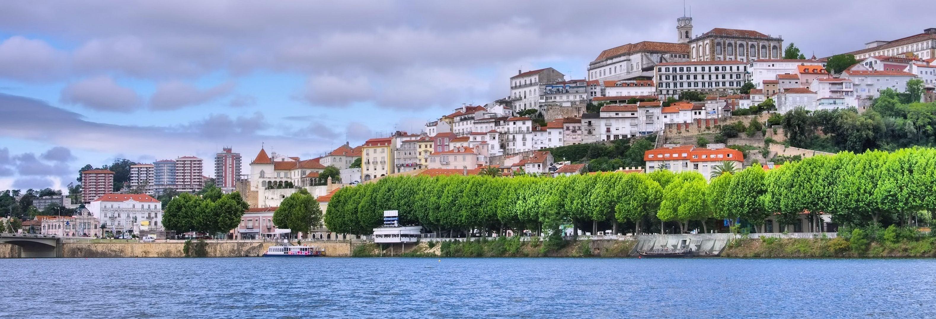 Autobús y barco turístico de Coímbra